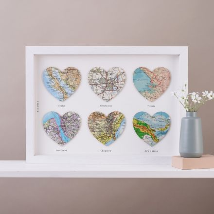 Six map heats in white wood frame. A few words chosen by customer printed under each heart and date printed down left side.