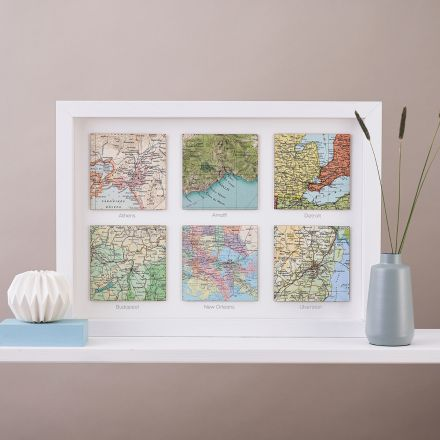 Six map location squares in white wood frame with printed personalisation under each square.