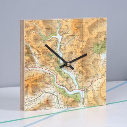 Map location square clock, faced in Scottish Highlands map in earthy tones. Clock on mantelpiece