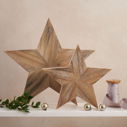 Beautiful handmade 5 point star ornaments. The stars are made from 5 kite shape pieces. Two sizes.