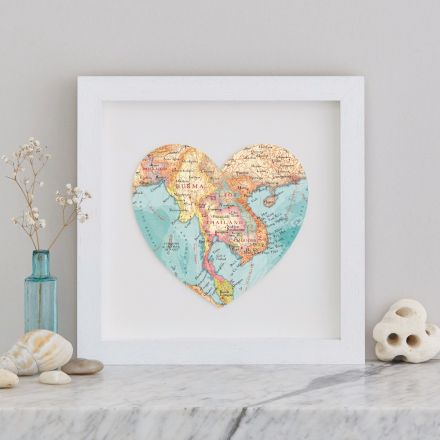 Map heart of Thailand mounted on white card and framed in square white wood box frame.