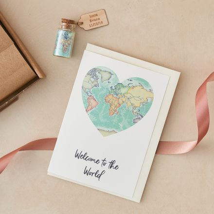 New baby letterbox gift, world map card and world map miniature bottle with wooden tag.