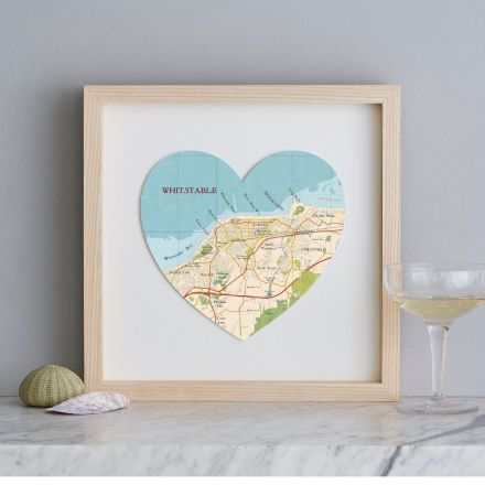 Whitstable map heart print with light wood frame.