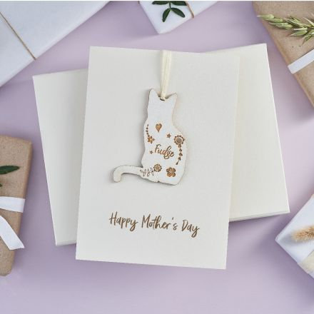 Engraved wooden cat keepsake strung on card printed with 'Happy Mother's day'