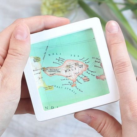 Miniature square white wood frame with pretty hand drawn map of Bali.