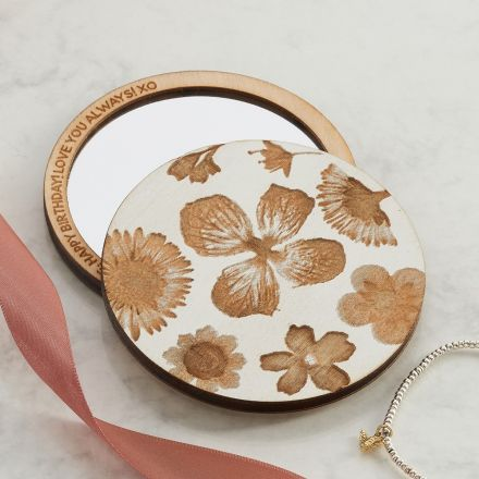 Pocket mirror etched with pressed flower design and personalised message printed around mirror's edge.