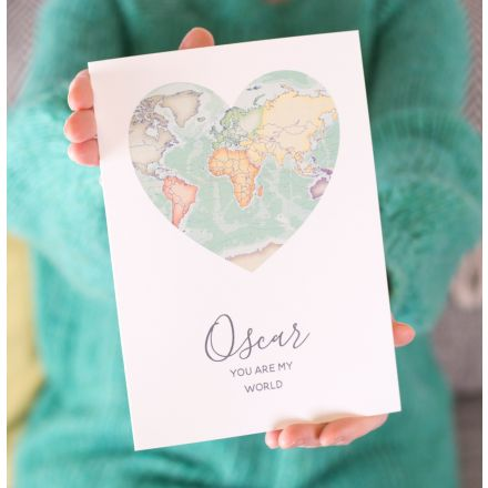 Card with map of the world in heart shape with 'Alex, you are my world' printed beneath.