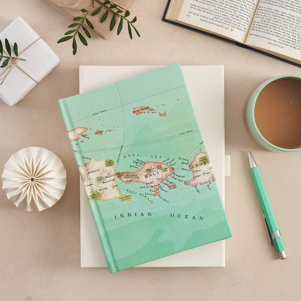 Bali map notebook in light mint green with a cup of tea