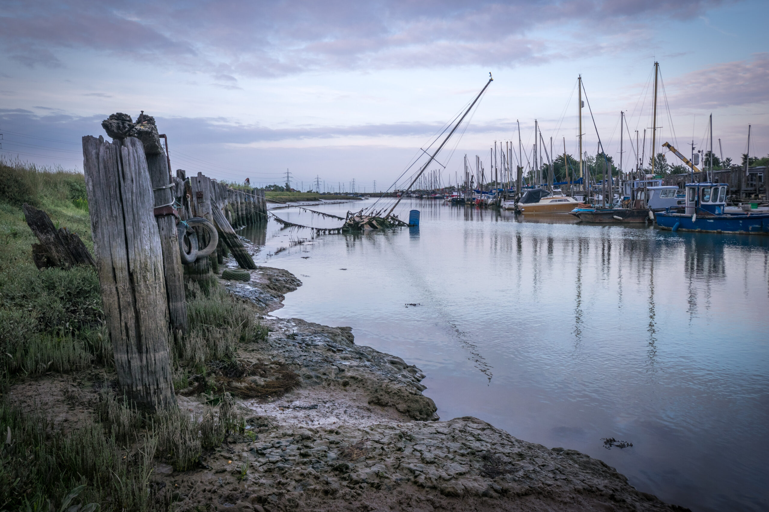 Moody photo of ship masts on Faversham creek.