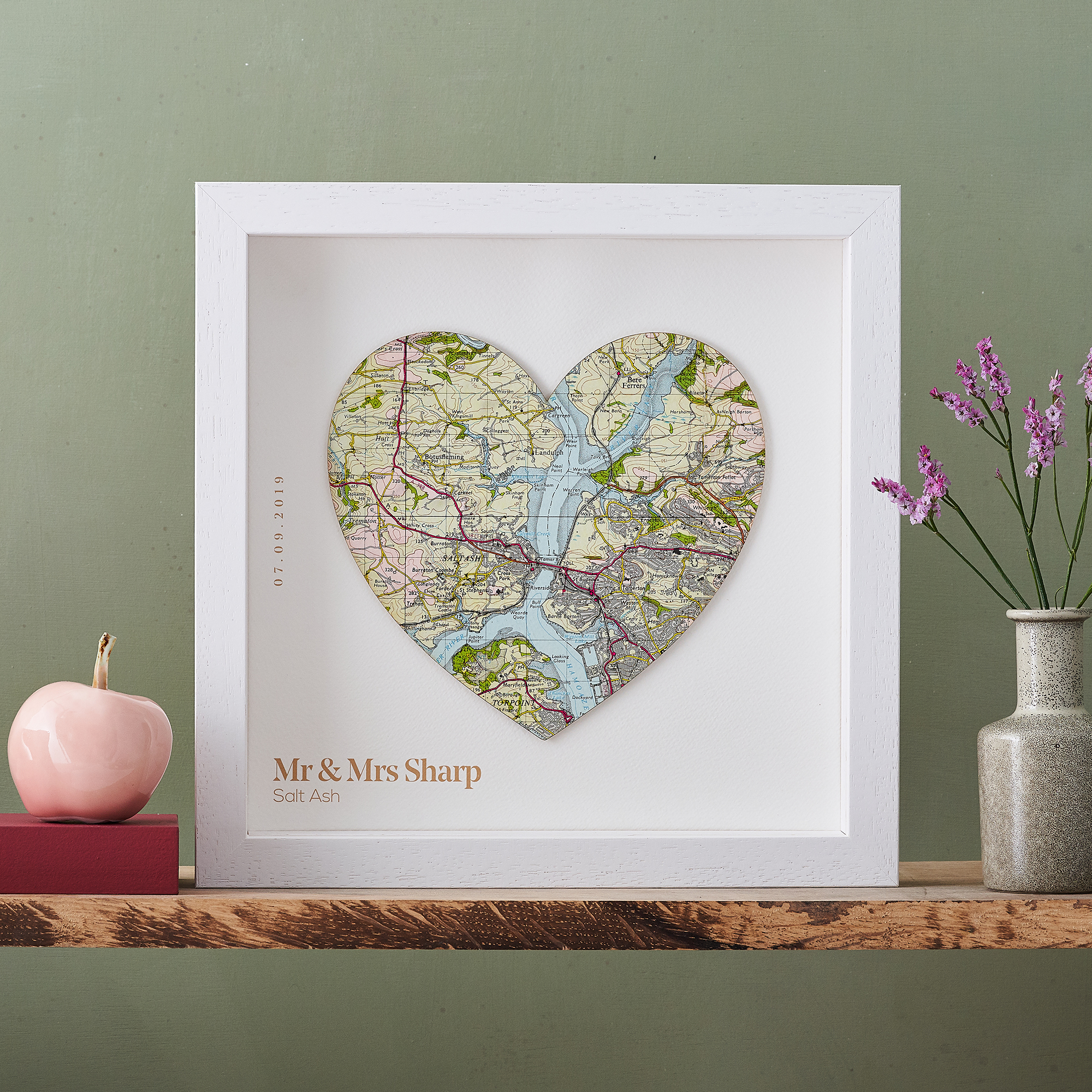 Map Heart framed in white on a green background.