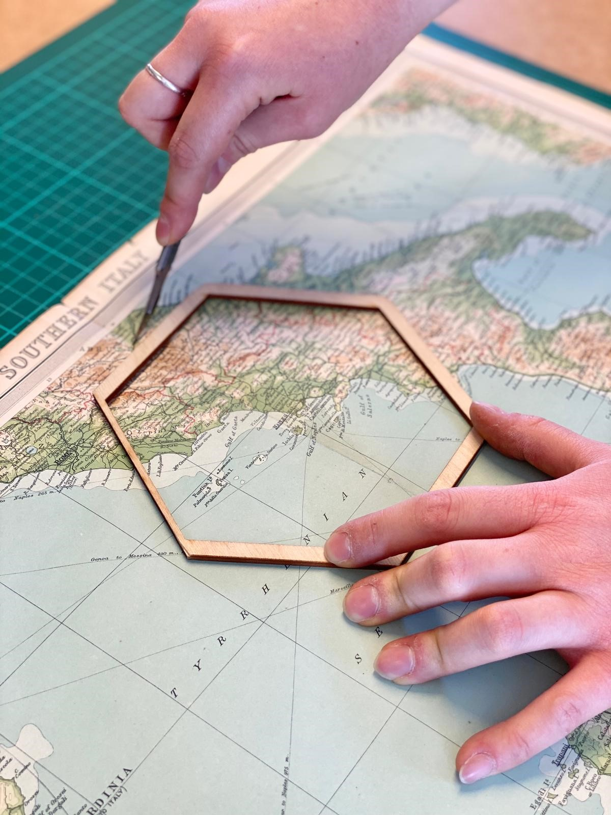 Close up of a piece of map being cut for a personalised map hexagon