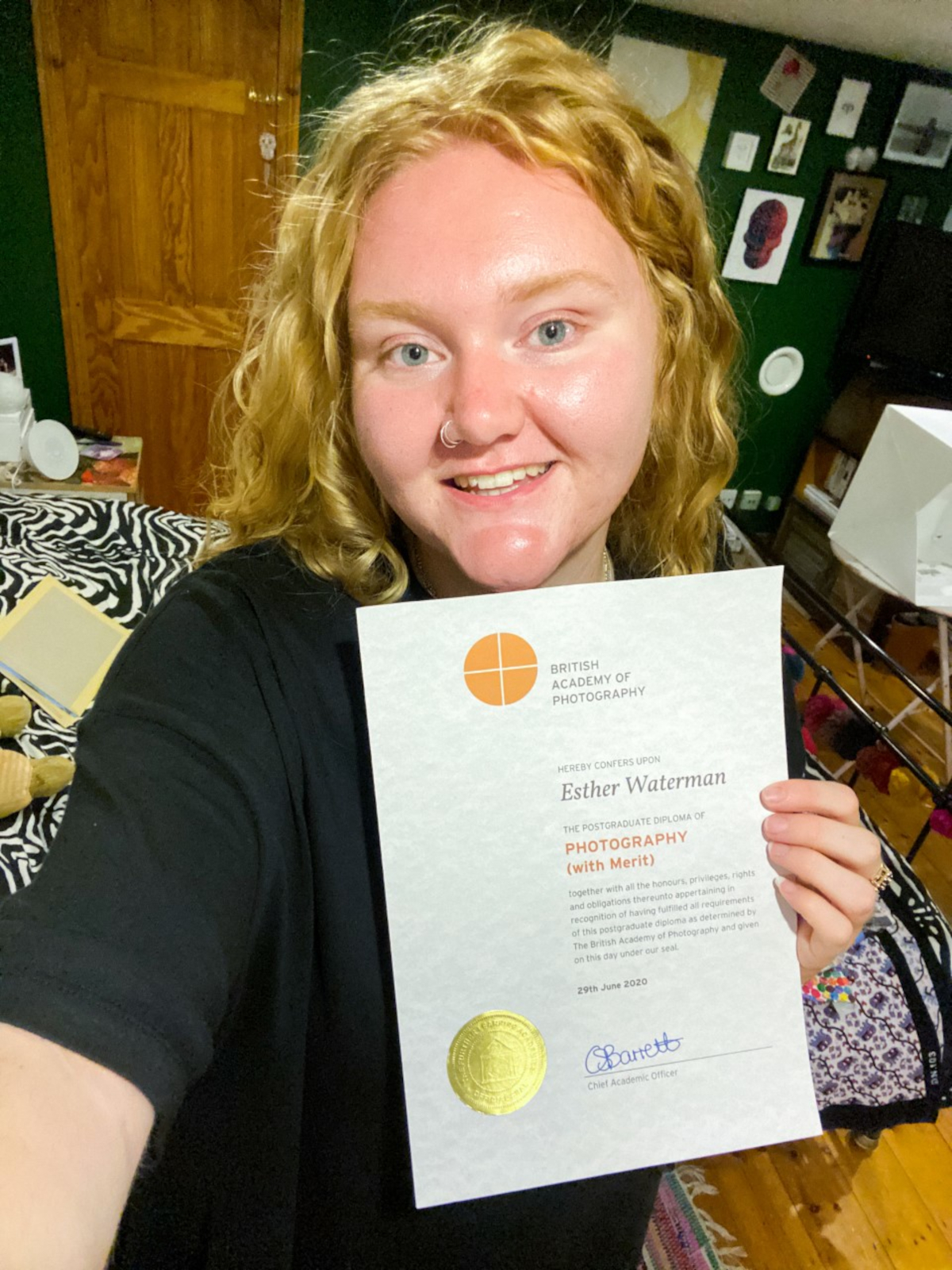 Bombus team member Esther with her postgraduate diploma in photography
