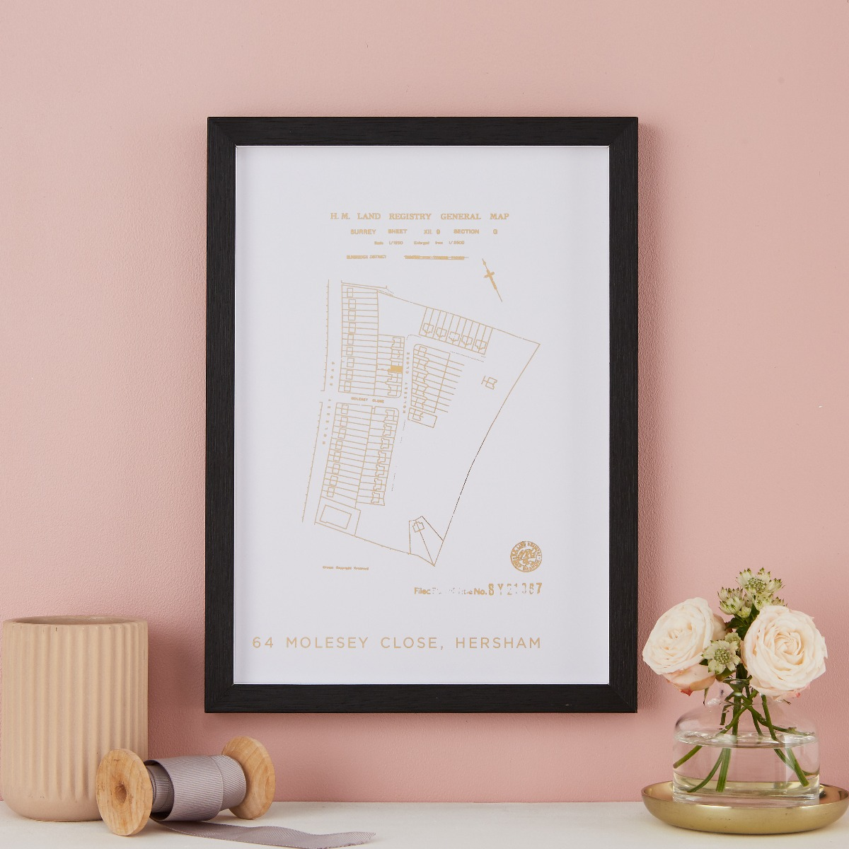 A land registry foiled print of their new home
